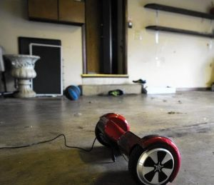 A hoverboard purchased by Doris Yadav for her two sons sits in the family's garage in Frankfor while it charges on Jan. 16, 2016. She insists the hoverboard stay in the garage while charging in case it catches fire. (Armando L. Sanchez / Chicago Tribune)